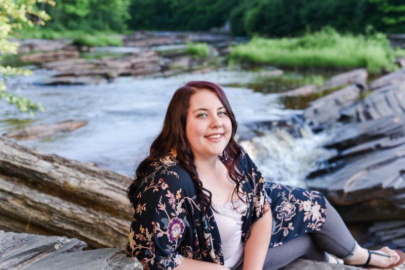 High school senior girl posing at Bonanza Falls in Ontonagon, Michigan