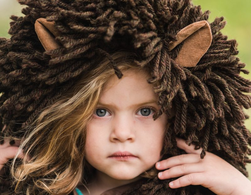 little girl with a lion coat hood