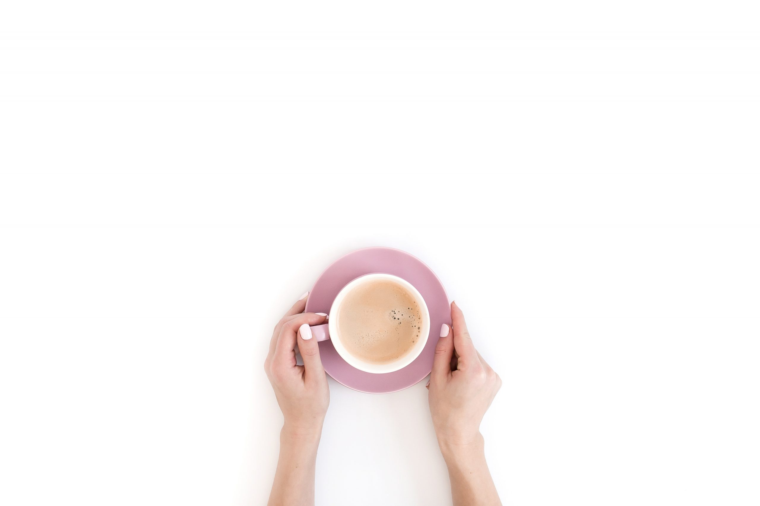 woman with pink nail polish holds a cup of coffee for session faqs