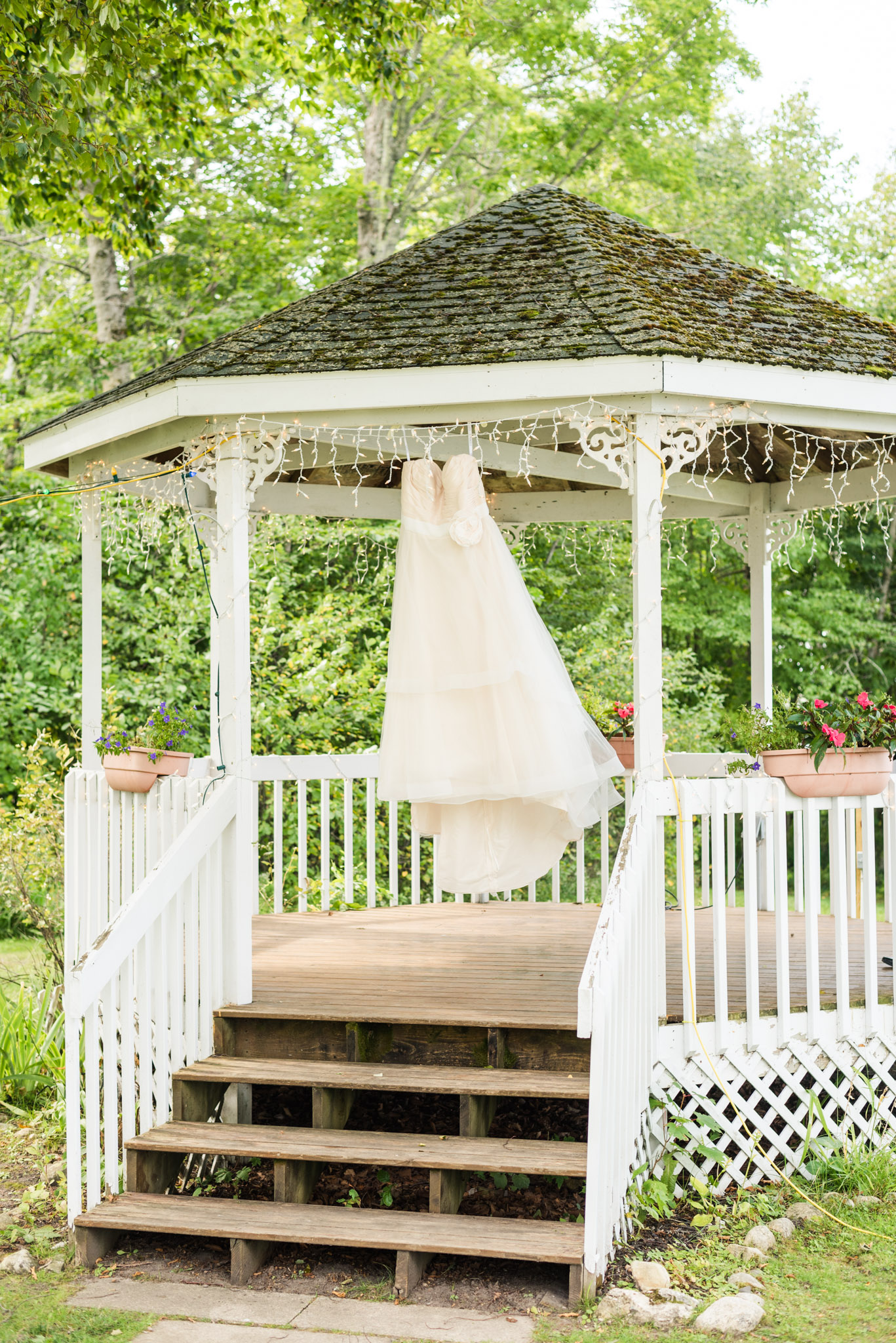wedding at chamberlins ole forest inn, wedding details, wedding gown hanging in gazebo