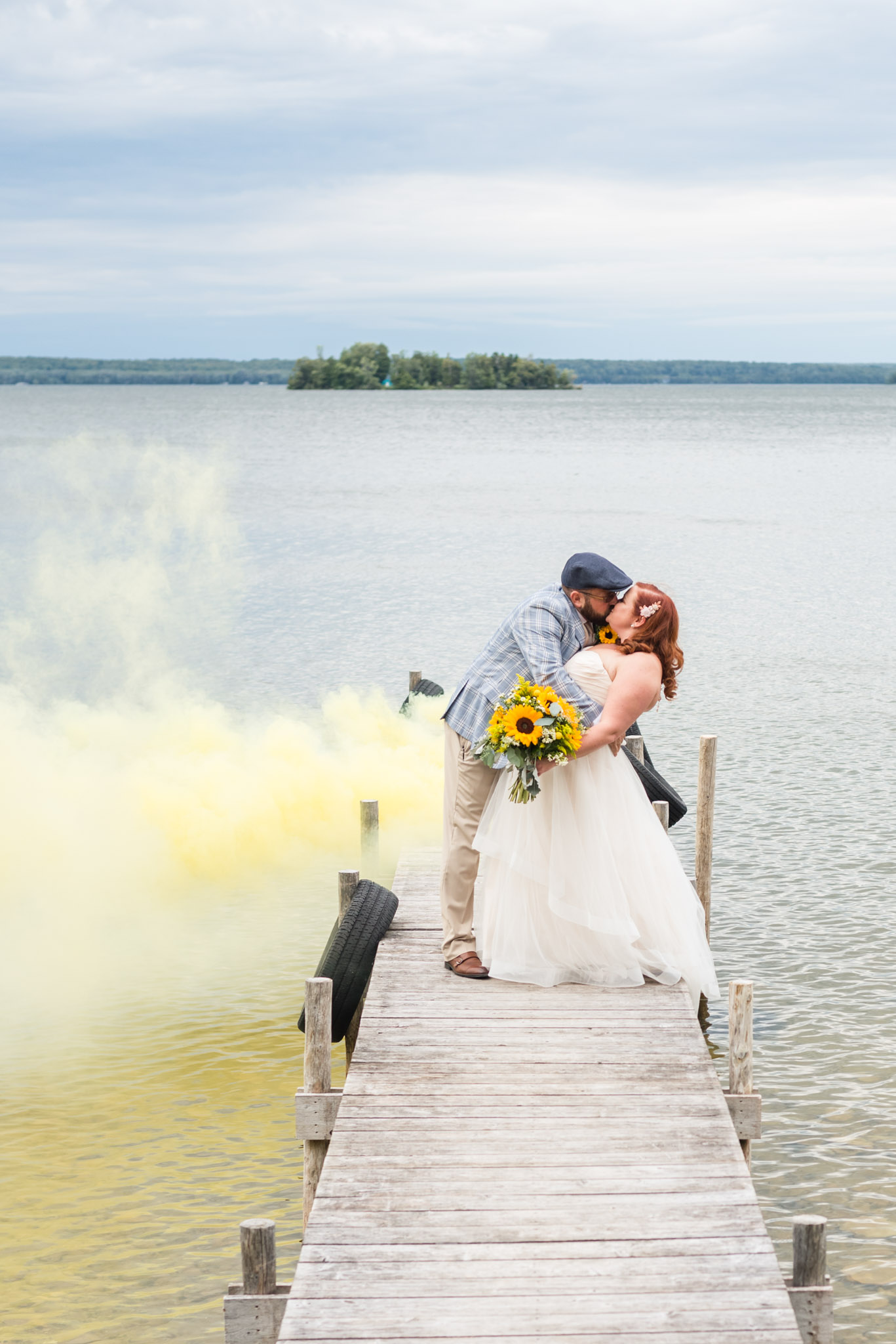 upper peninsula wedding photographer, wedding pictures with smoke bombs at chamberlins ole forest inn