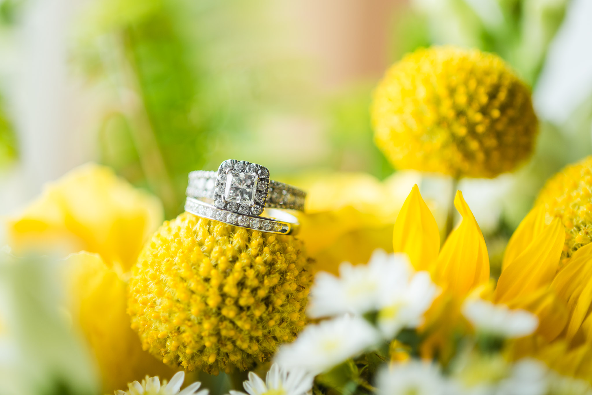 wedding details, bride rings on yellow flowers