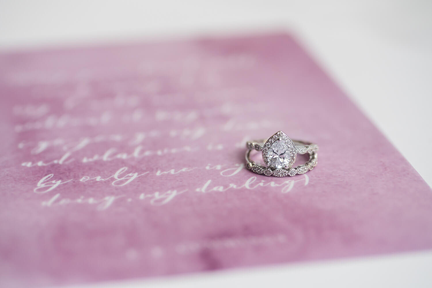 wedding details, rings on invitation suite