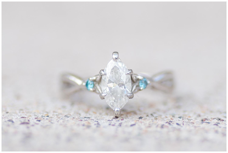 engagement ring shot on white step