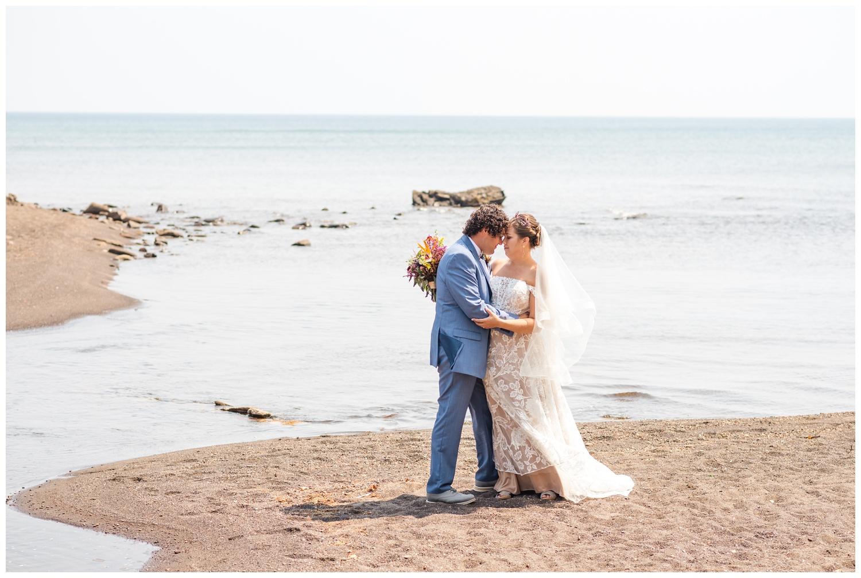 bride and groom portraits at tobacco river park beach before keweenaw wedding