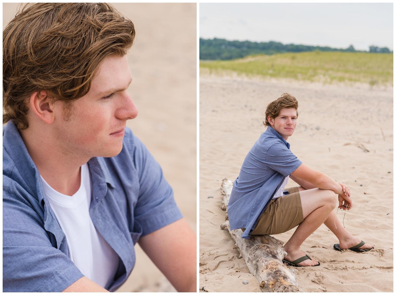 boy high school senior session on grand marais mi beach