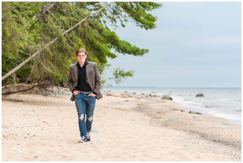 high school boy senior session on grand marais mi beach