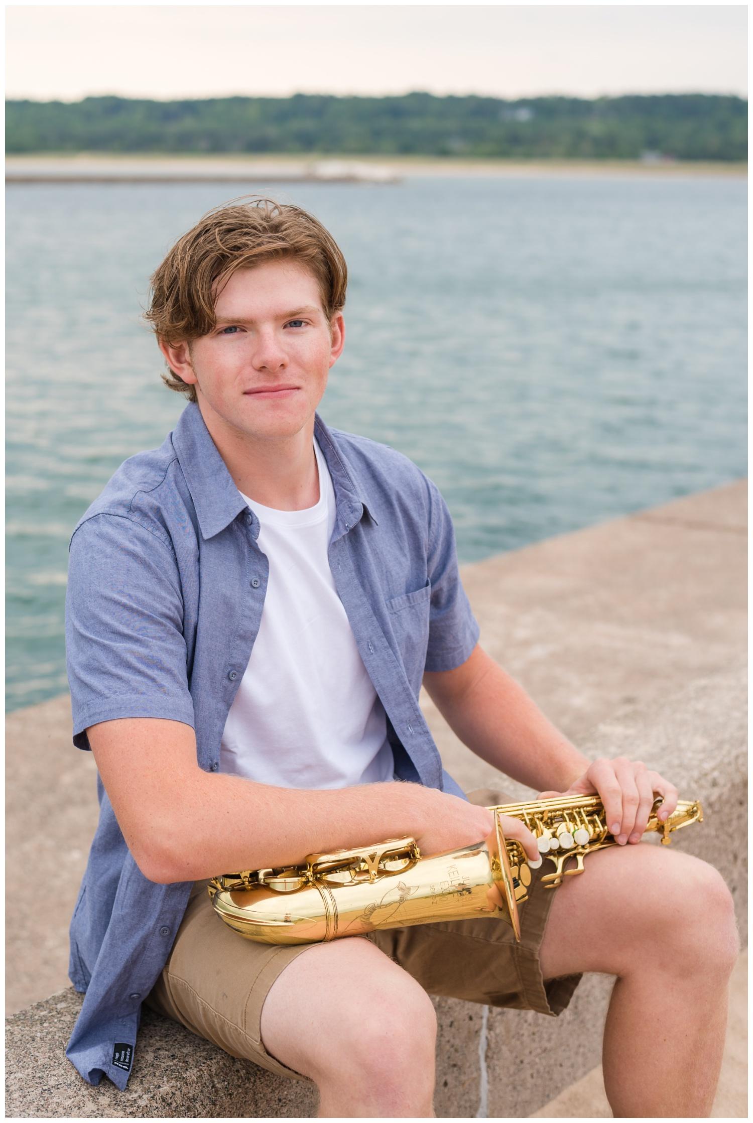 high school senior boy with saxophone